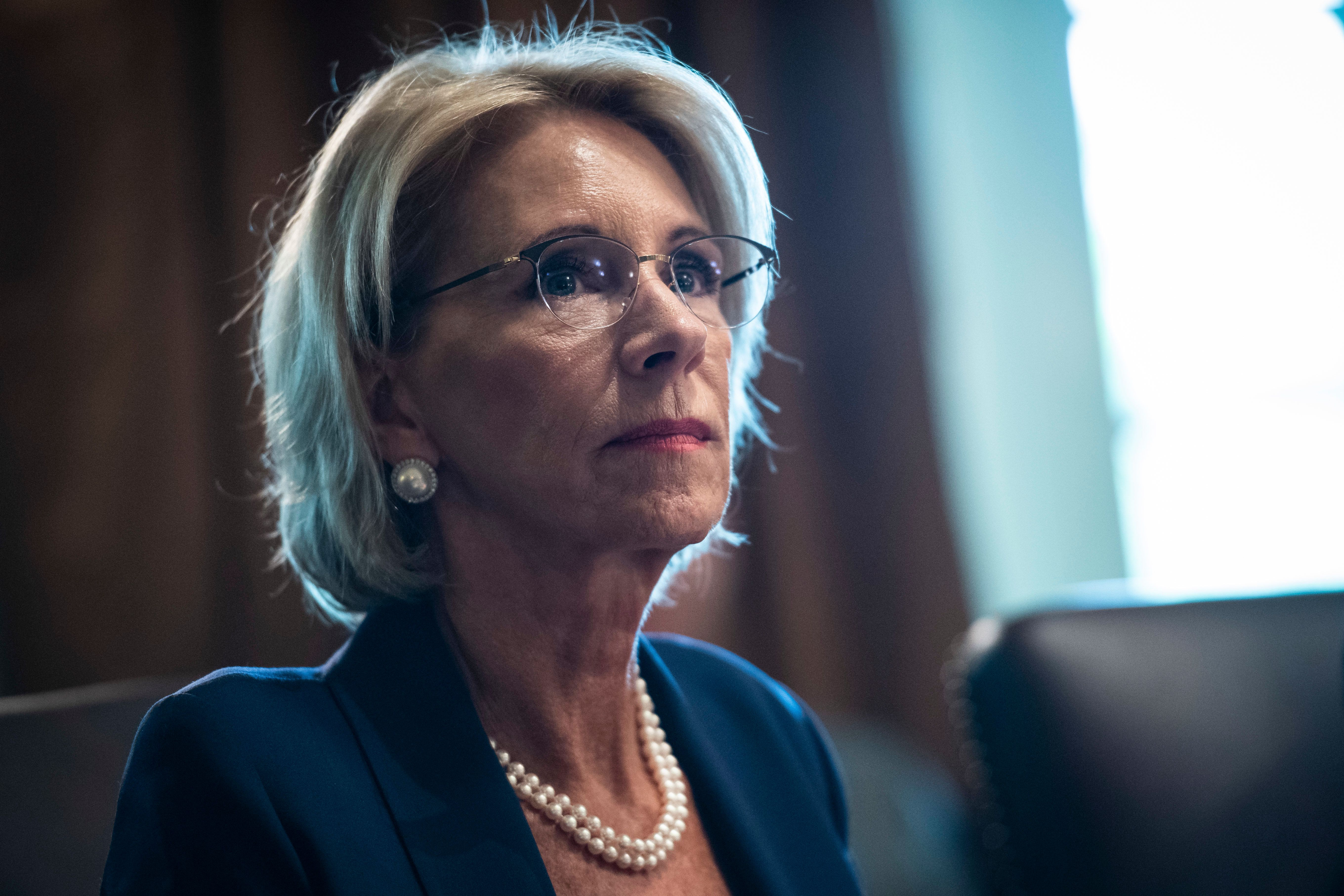 WASHINGTON, DC - AUGUST 16 : Secretary of Education Betsy DeVos listens as President Donald J. Trump speaks during a Cabinet meeting in the Cabinet Room of the White House on Thursday, Aug 16, 2018 in Washington, DC. (Photo by Jabin Botsford/The Washington Post via Getty Images)