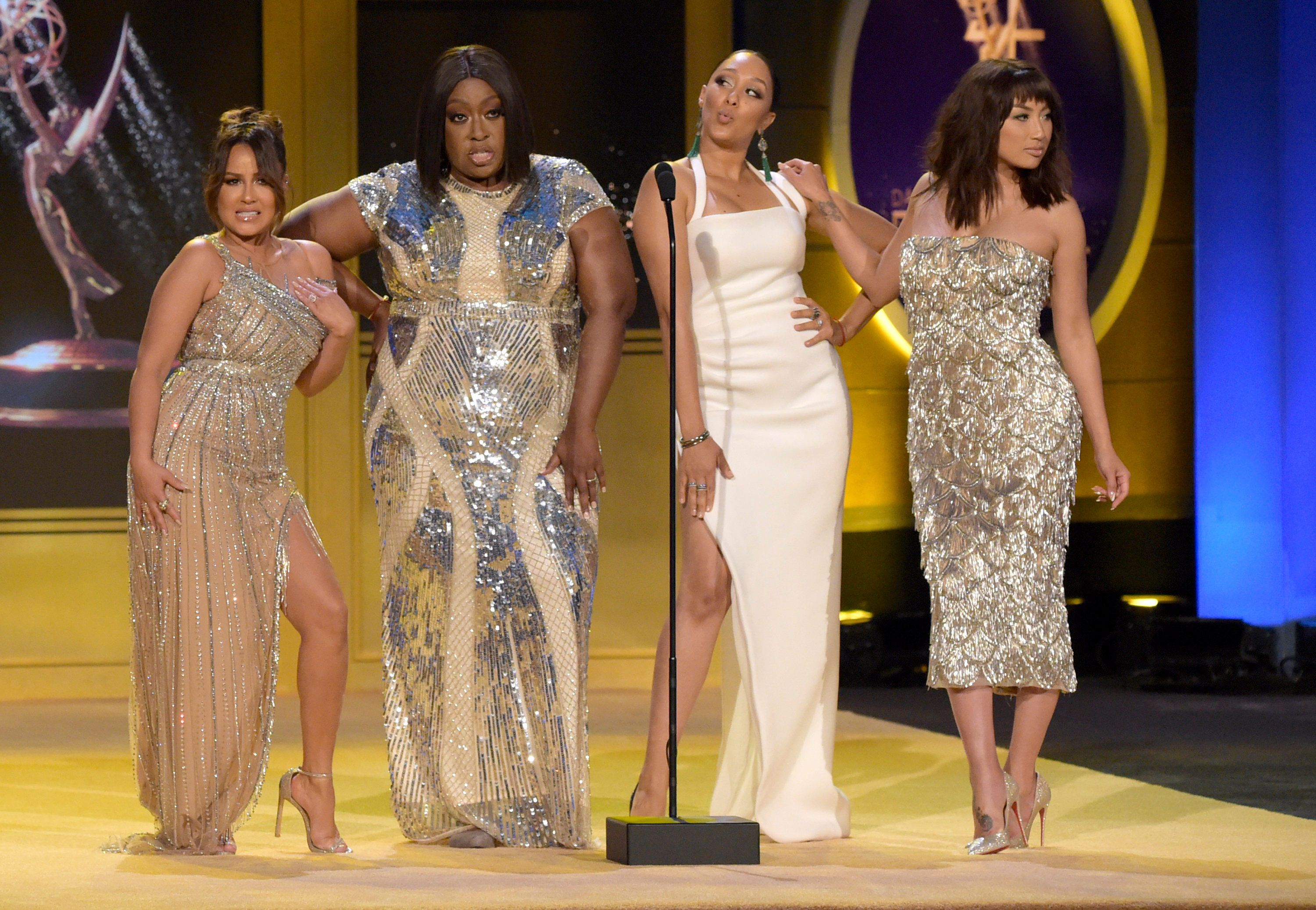 "Adrienne Houghton, from left, Loni Love, Tamera Mowry-Housley and Jeannie Mai, members of the cast of ""The Real,"" present the award for outstanding guest performer in a drama series at the 45th annual Daytime Emmy Awards at the Pasadena Civic Center on Sunday, April 29, 2018, in Pasadena, Calif. (Photo by Richard Shotwell/Invision/AP)"