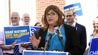 IMAGE DISTRIBUTED FOR HUMAN RIGHTS CAMPAIGN - Christine Hallquist of Hyde Park, VT, candidate for Governor of Vermont, speaks alongside supporters, politicians and Human Rights Campaign President Chad Griffin after his introduction at HRC's Rally and Endorsement for Christine Hallquist at Burlington City Hall in Burlington, VT on Wednesday, August 29, 2018. Hellquist, a Democrat from Hyde Park, VT, is the first transgender candidate to be nominated for a governorship by a major party. (Alison Redlich/AP Images for Human Rights Campaign)