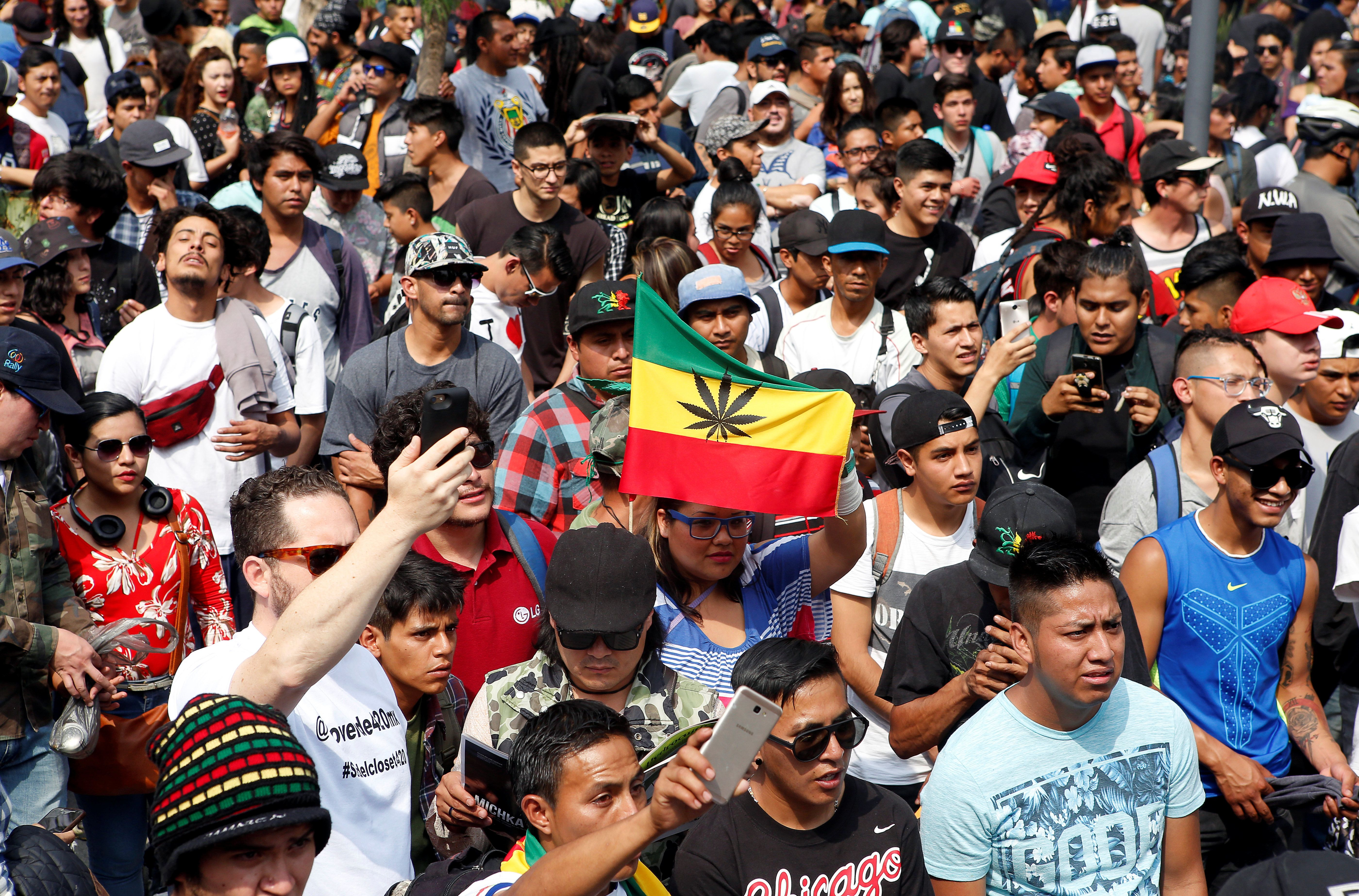 People take part in a march through the streets in support of the legalization of marijuana, in Mexico City, Mexico May 5, 2018.REUTERS/Ginnette Riquelme