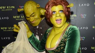 Model and television personality Heidi Klum, right, and boyfriend Tom Kaulitz dressed as Shrek and Princess Fiona arrive at her 19th annual Halloween party at Lavo New York on Wednesday, Oct. 31, 2018, in New York. (Photo by Evan Agostini/Invision/AP)