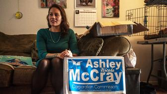 Ashley McCray looks over campaign signs and handmade t-shirts deciding what to send out with a volunteer thats coming over to get supplies.