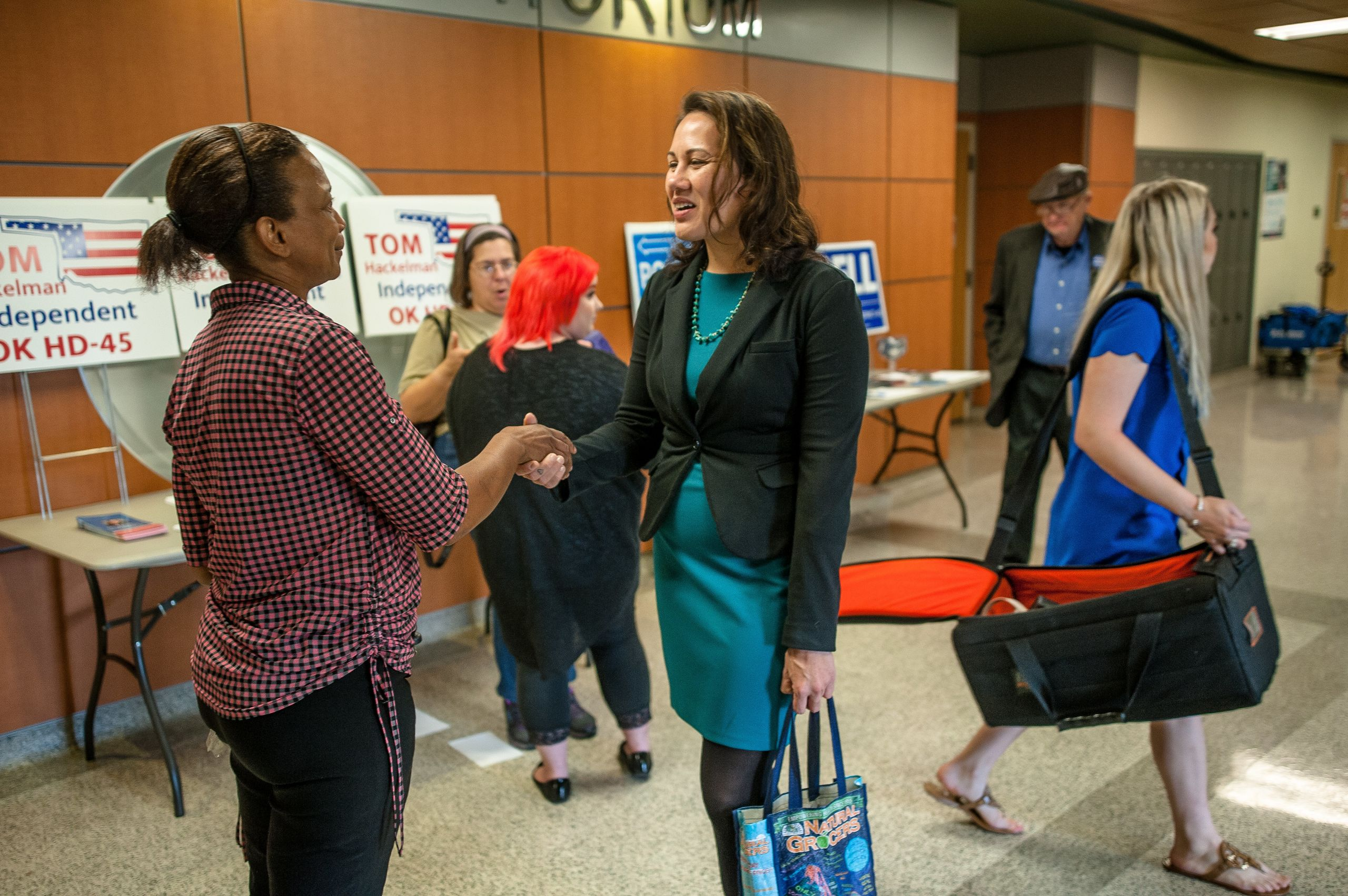McCray talks to a constituent at a candidate forum in Oklahoma City.