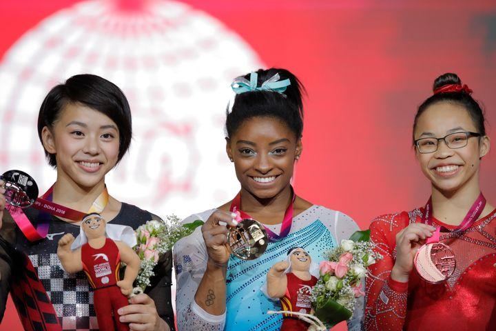 Japan's Mai Murakami (left) came in second place in the all-around competition with 55.798 points, Biles came in first