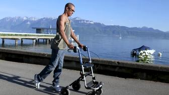 Man walks again after spinal cord implants
