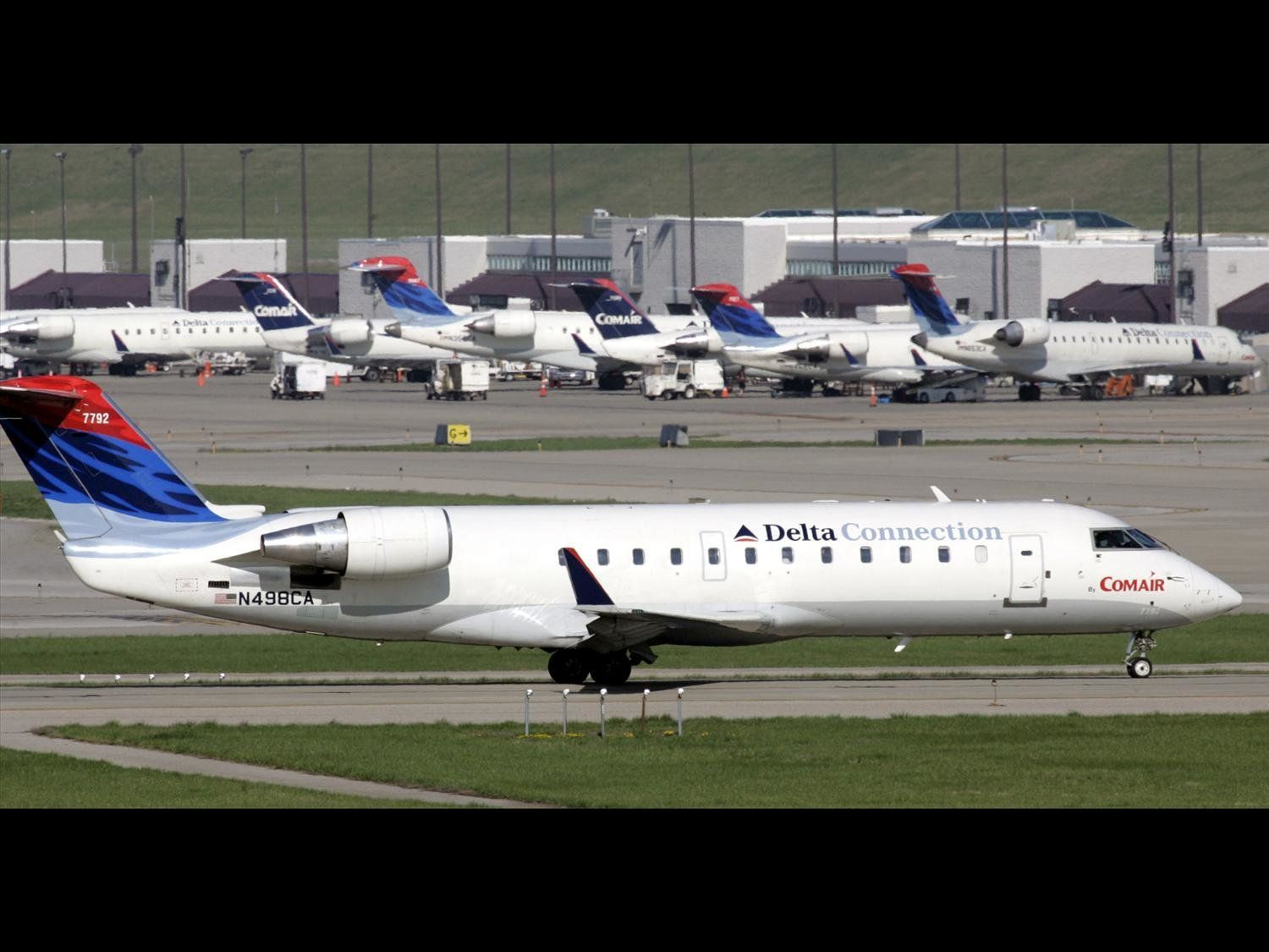 Comair Bombardier CRJ-200 regional jet, Greater Cincinnati/Northern Kentucky International Airport, Hebron, Kentucky, photo on black