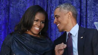 WASHINGTON, DC - FEBRUARY 12:  Former U.S. President Barack Obama and first lady Michelle Obama participate in the unveiling of their official portraits during a ceremony at the Smithsonian's National Portrait Gallery, on February 12, 2018 in Washington, DC. The portraits were commissioned by the Gallery, for Kehinde Wiley to create President Obama's portrait, and Amy Sherald that of Michelle Obama.  (Photo by Mark Wilson/Getty Images)