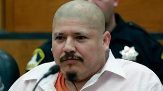 FILE - In this Feb. 9, 2018 file photo, Luis Bracamontes glares at the jury as the verdict is read in the killing of two law enforcement officers, in Sacramento Superior Court in Sacramento, Calif. Bracamontes was found guilty of shooting Sacramento County sheriff's Deputy Danny Oliver in 2014, then killing Placer County sheriff's Detective Michael Davis Jr. hours later. Jurors recommend the death penalty for Bracamontes. (AP Photo/Rich Pedroncelli, File)