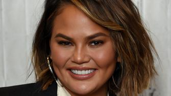 "Model Chrissy Teigen poses backstage before participating in the BUILD Speaker Series to discuss her new cookbook ""Cravings: Hungry for More"" and her new ""Cravings"" cookware line at AOL Studios on Wednesday, Sept. 19, 2018, in New York. (Photo by Evan Agostini/Invision/AP)"