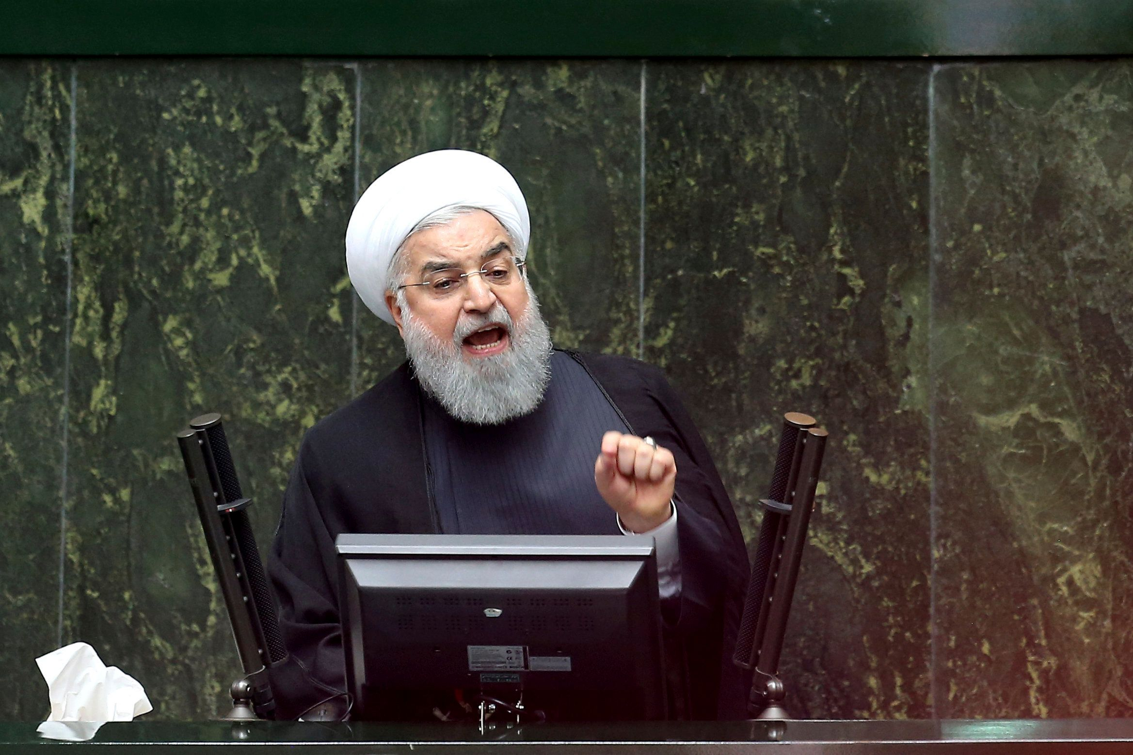 "Iranian President Hassan Rouhani speaks during parliament's open session on confidence vote for four new ministers, in Tehran, Iran, Saturday, Oct. 27, 2018. Rouhani urged Parliament to approve four new ministers and help his government ""resist"" and ""fight"" the U.S. as it reinstates sanctions against the Islamic Republic. (AP Photo/Ebrahim Noroozi)"