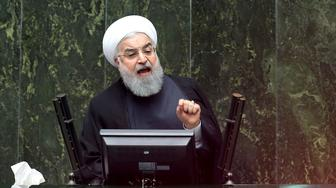 """Iranian President Hassan Rouhani speaks during parliament's open session on confidence vote for four new ministers, in Tehran, Iran, Saturday, Oct. 27, 2018. Rouhani urged Parliament to approve four new ministers and help his government """"resist"""" and """"fight"""" the U.S. as it reinstates sanctions against the Islamic Republic. (AP Photo/Ebrahim Noroozi)"""