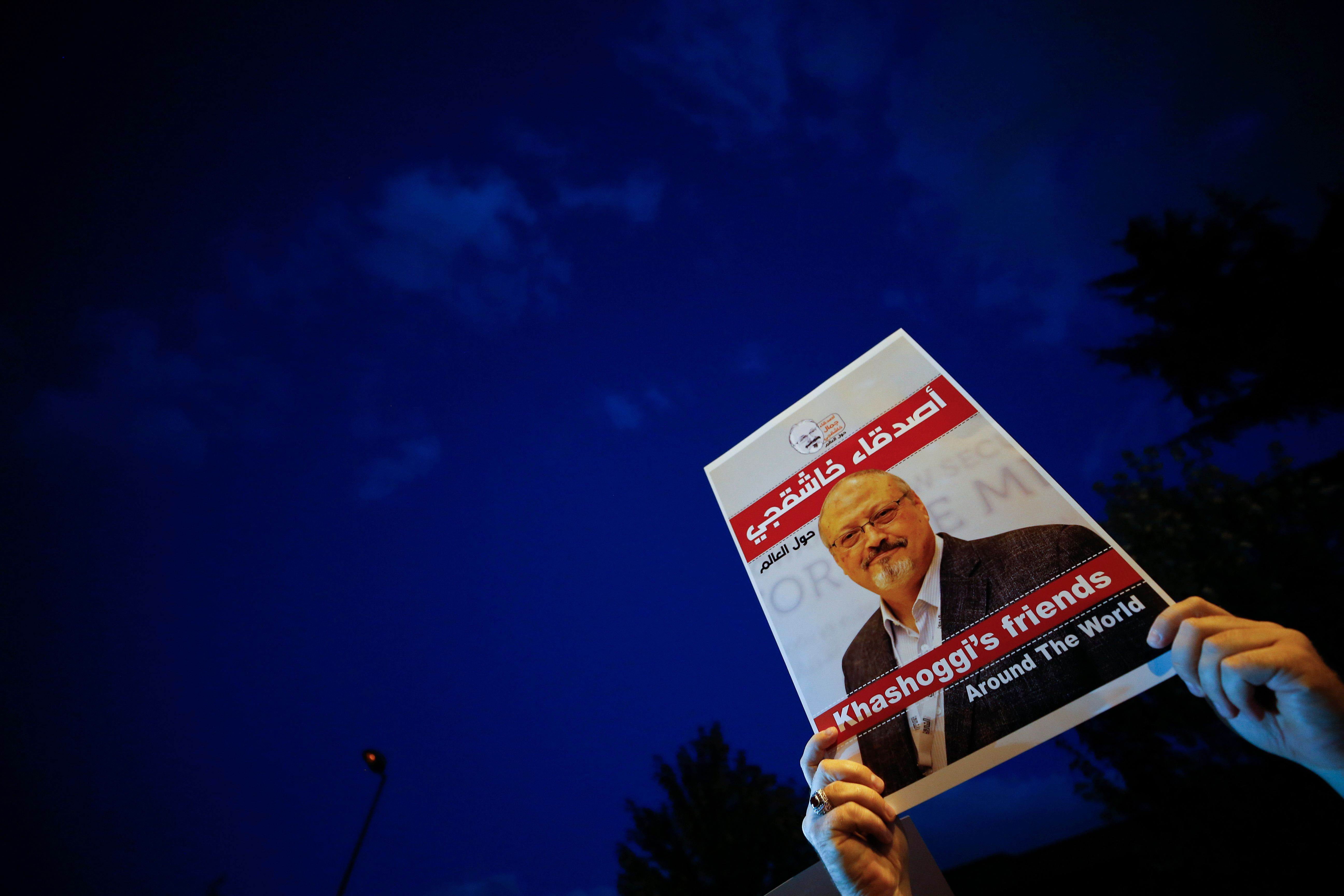 "Activists protesting the killing of Saudi journalist Jamal Khashoggi hold a candlelight vigil outside Saudi Arabia's consulate in Istanbul, Thursday, Oct. 25, 2018. The poster reads in Arabic:' Khashoggi's Friends Around the World'. A group of Arab and international public, political and media figures are establishing a global association called ""Khashoggi's Friends Around the World""; ""to achieve justice for the freedom martyr"".(AP Photo/Emrah Gurel)"
