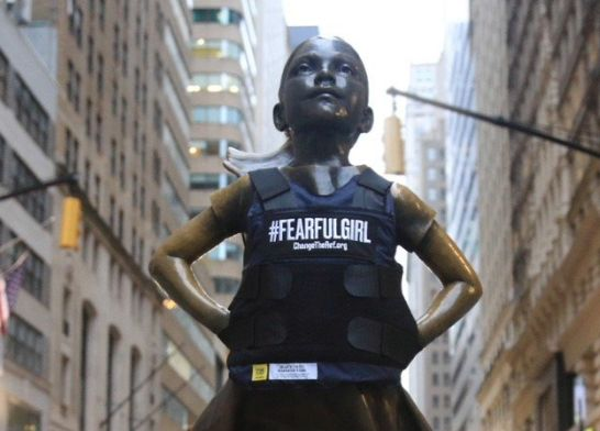 "Fearless Girl statue transformed into ""Fearful Girl"" with bulletproof vest"