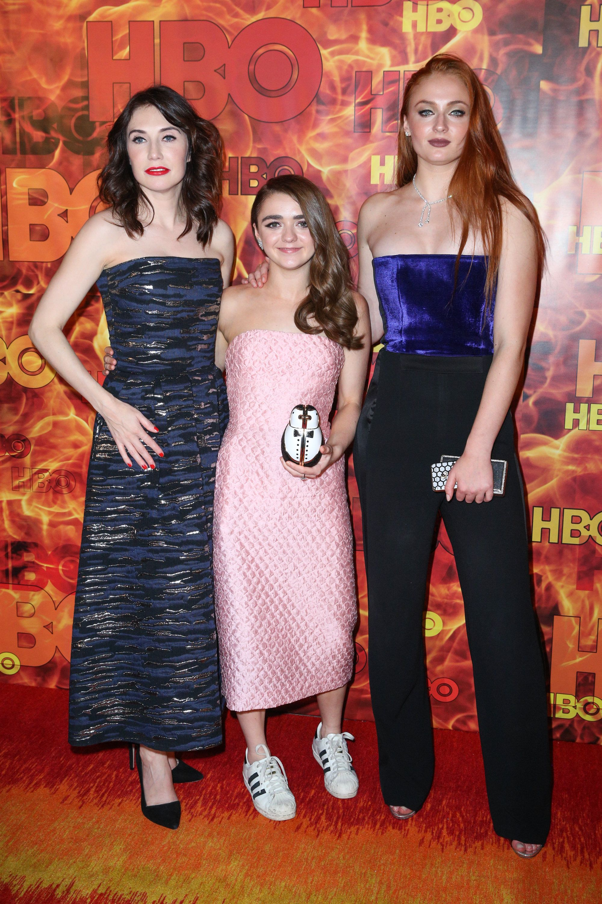 Carice van Houten, from left, Maisie Williams and Sophie Turner arrive at the 2015 HBO Primetime Emmy Awards After Party at Pacific Design Center on Sunday, Sept. 20, 2015, in West Hollywood, Calif. (Photo by Rich Fury/Invision/AP)