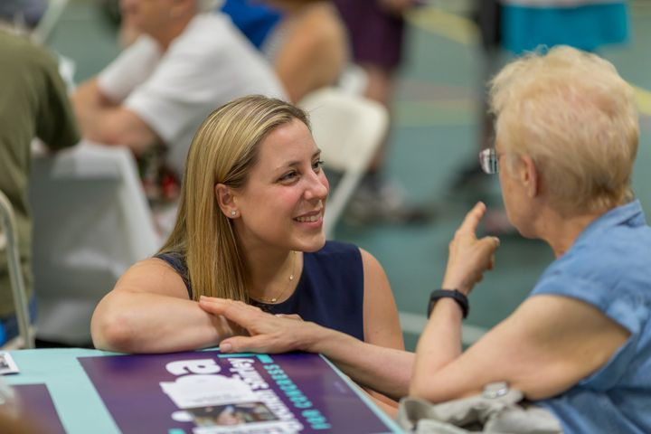 Liuba Grechen Shirley, 37, speaks to a voter in New York's 2nd Congressional District.