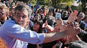 CARROLLTON, TEXAS - NOVEMBER 02: U.S. Senate candidate Rep. Beto O'Rourke (D-TX) shakes hands with supporters during a campaign rally at Harvest Run Park November 2, 2018 in Carrollton, Texas. As Election Day approaches, winning swing votes in the suburbs that surround Dallas and Fort Worth will be crucial in a statewide victory for O'Rourke and his opponent incumbent Sen. Ted Cruz (R-TX).  (Photo by Chip Somodevilla/Getty Images)