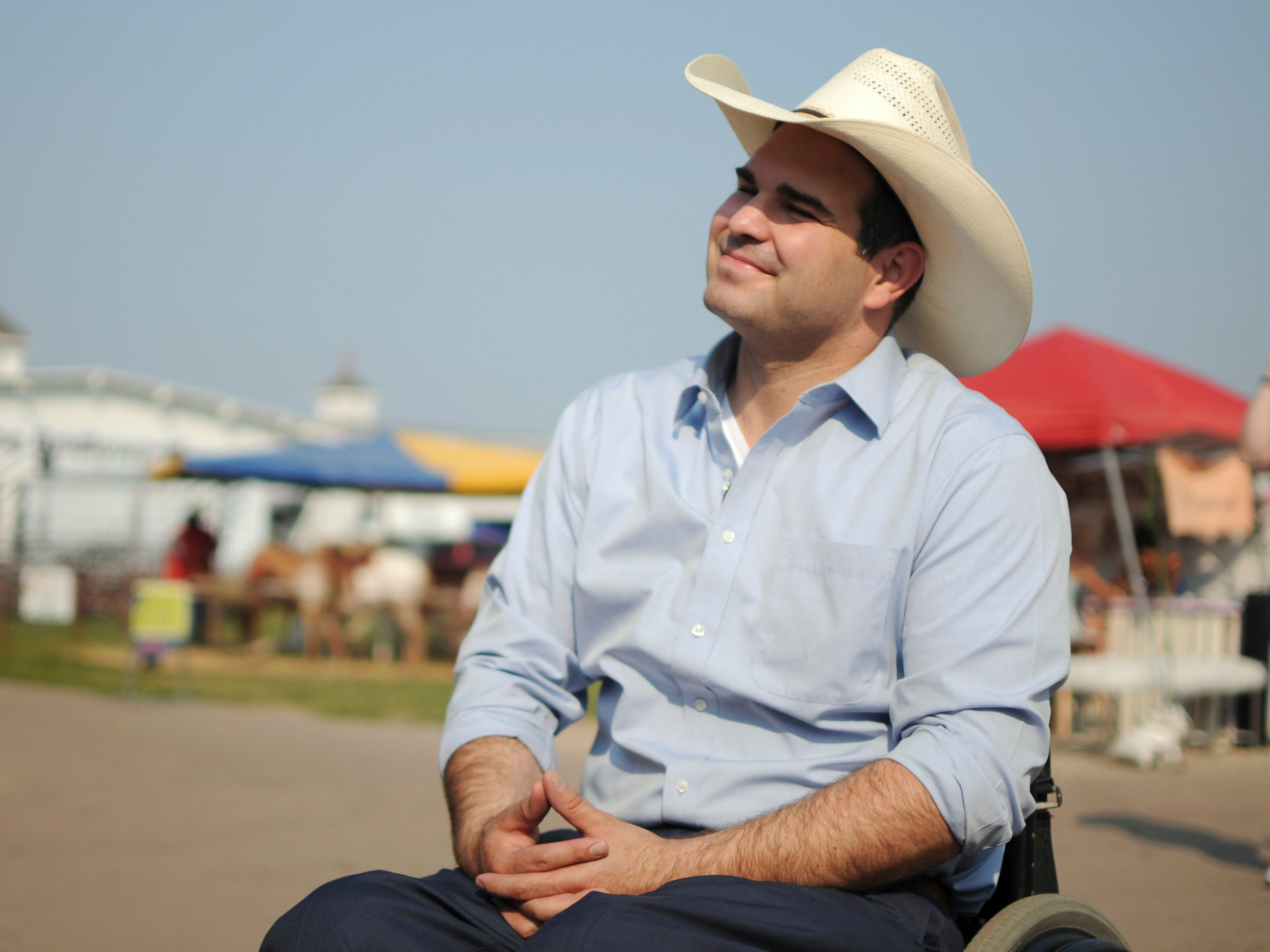 In this Aug. 10, 2018, photo, Democratic governor candidate Billie Sutton campaigns at a fair in Sioux Falls, S.D. Sutton is seeking to become the first Democrat elected South Dakota governor in over four decades. (AP Photo/James Nord)