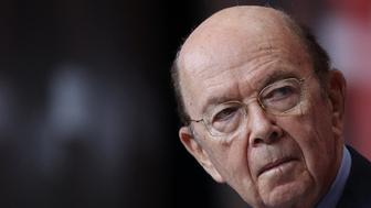 """""""When a foreign company engages in activity contrary to our national security interests, we will take strong action to protect our national security,"""" Commerce Secretary Wilbur Ross said in a statement (AFP Photo/WIN MCNAMEE)"""