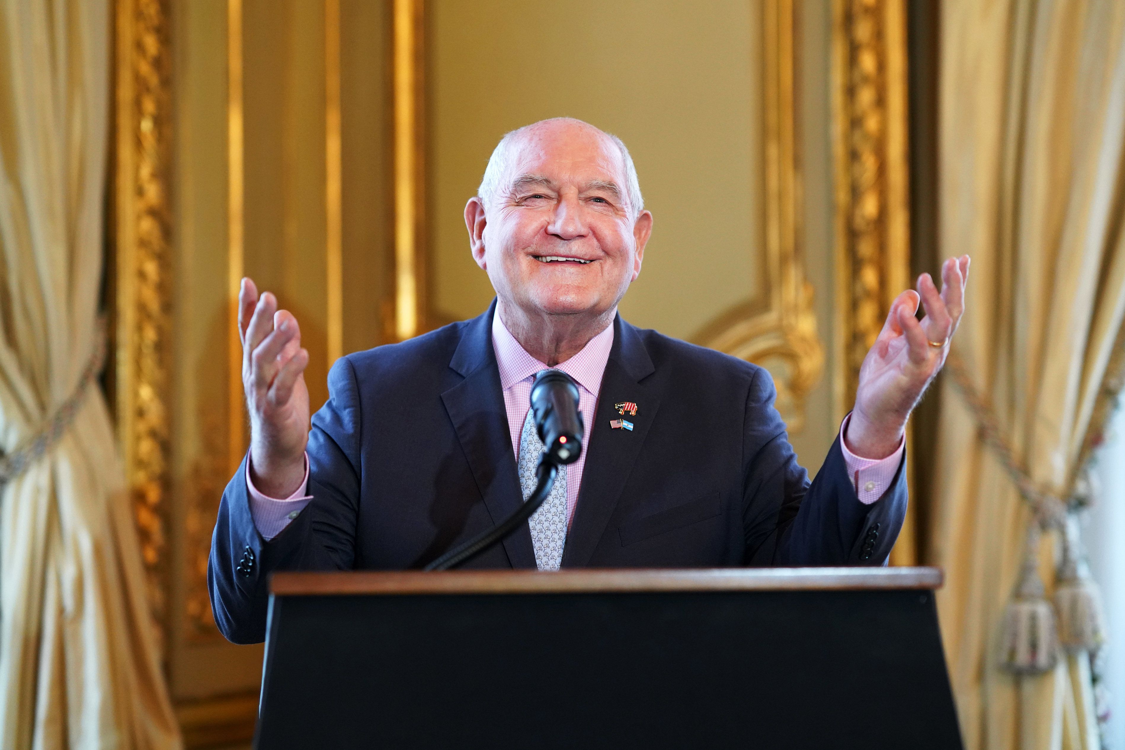 Sonny Perdue, U.S. secretary of agriculture, gestures while speaking during an event at the U.S. Embassy in Buenos Aires, Argentina, on Saturday, July 28, 2018. At the event to celebrate the recent entry of American pork into the Argentine market, Perdue said that American farmers will soon see the first payments of a $12 billion subsidyprogramdesigned to shield them from a burgeoning trade war. Photographer: Pablo E. Piovano/Bloomberg via Getty Images