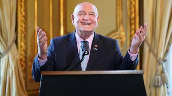 Sonny Perdue, U.S. secretary of agriculture, gestures while speaking during an event at the U.S. Embassy in Buenos Aires, Argentina, on Saturday, July 28, 2018. At the event to celebrate the recent entry of American pork into the Argentine market, Perdue said that American farmers will soon see the first payments of a $12 billion subsidy program designed to shield them from a burgeoning trade war. Photographer: Pablo E. Piovano/Bloomberg via Getty Images