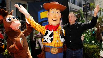 "Actor Tom Hanks (R) waves at fans with character Woody (C), whose voice he plays in the film, and character Bullseye (L) as he arrives at the world premiere of Disney Pixar's ""Toy Story 3"" at the El Capitan Theatre in Hollywood, California June 13, 2010. REUTERS/Danny Moloshok (UNITED STATES - Tags: ENTERTAINMENT PROFILE)"