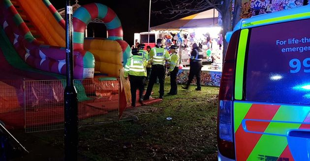 Police were seen inspecting the inflatable slide after the casualties had been transported to