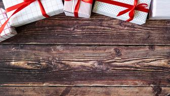 Christmas gift boxes on woodden table background with vintage effect color.
