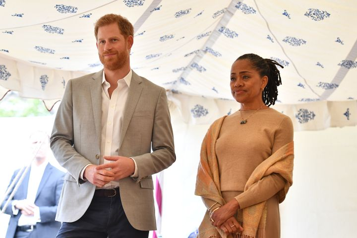 Prince Harry and Doria Ragland listen to the Duchess of Sussex speaking at an event to mark the launch of a cookbook with rec