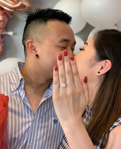 Woman models cousin's engagement ring in hilarious viral proposal photo