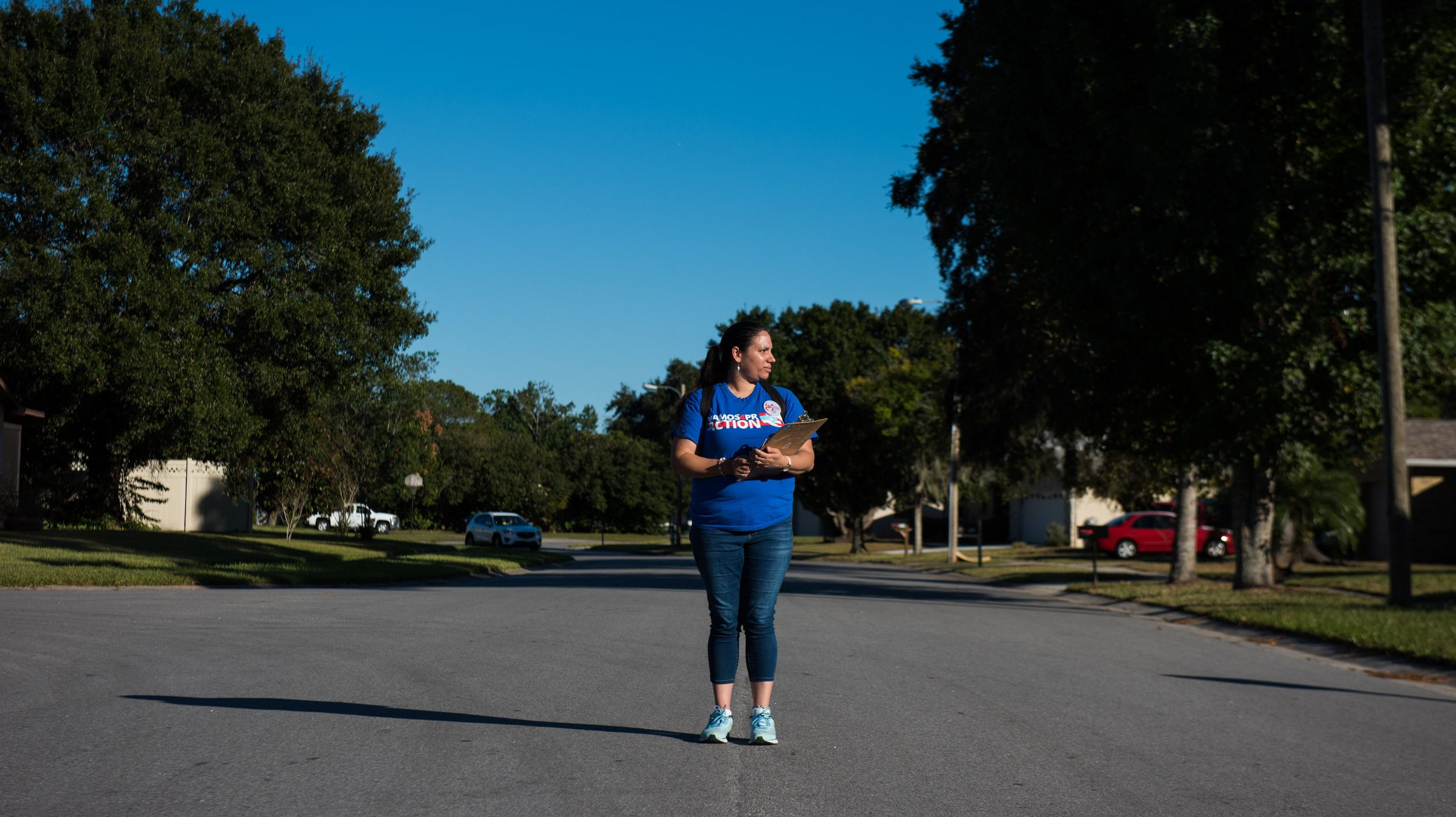 Arleen Sevilla poses for a photo while canvassing in the Chickasaw Woods subdivision in Orlando, Florida, on Oct. 30, 2018.