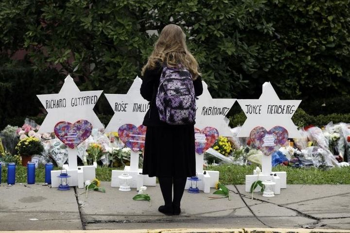 A mourner stands in front of a memorial set up for some victims of the synagogue shooting in Pittsburgh.