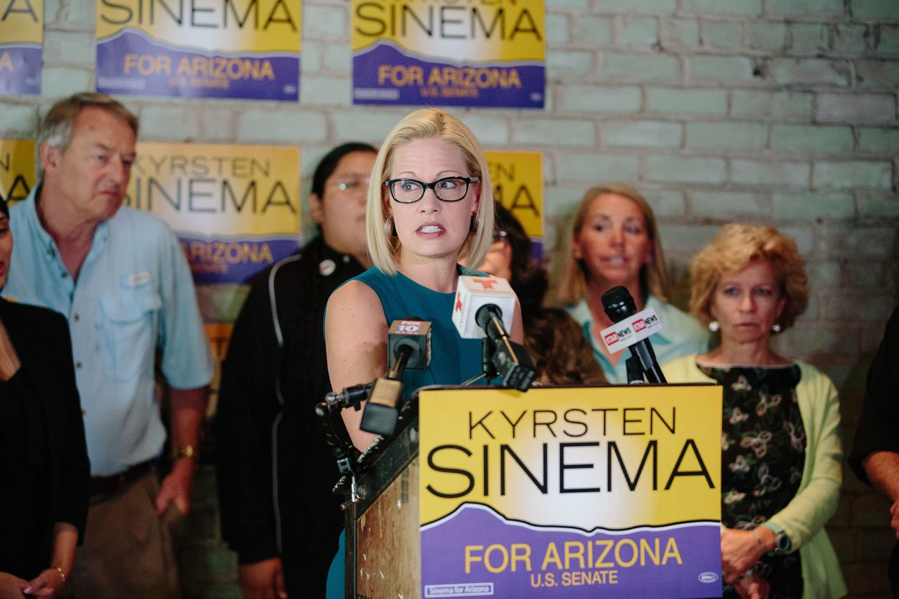 Sinema answers questions at a campaign event in Phoenix on Oct. 24.