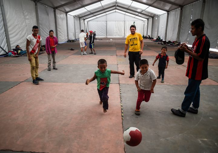 People traveling north from Central America play football at a temporary shelter in Mexico City on Nov. 5. Mexico'