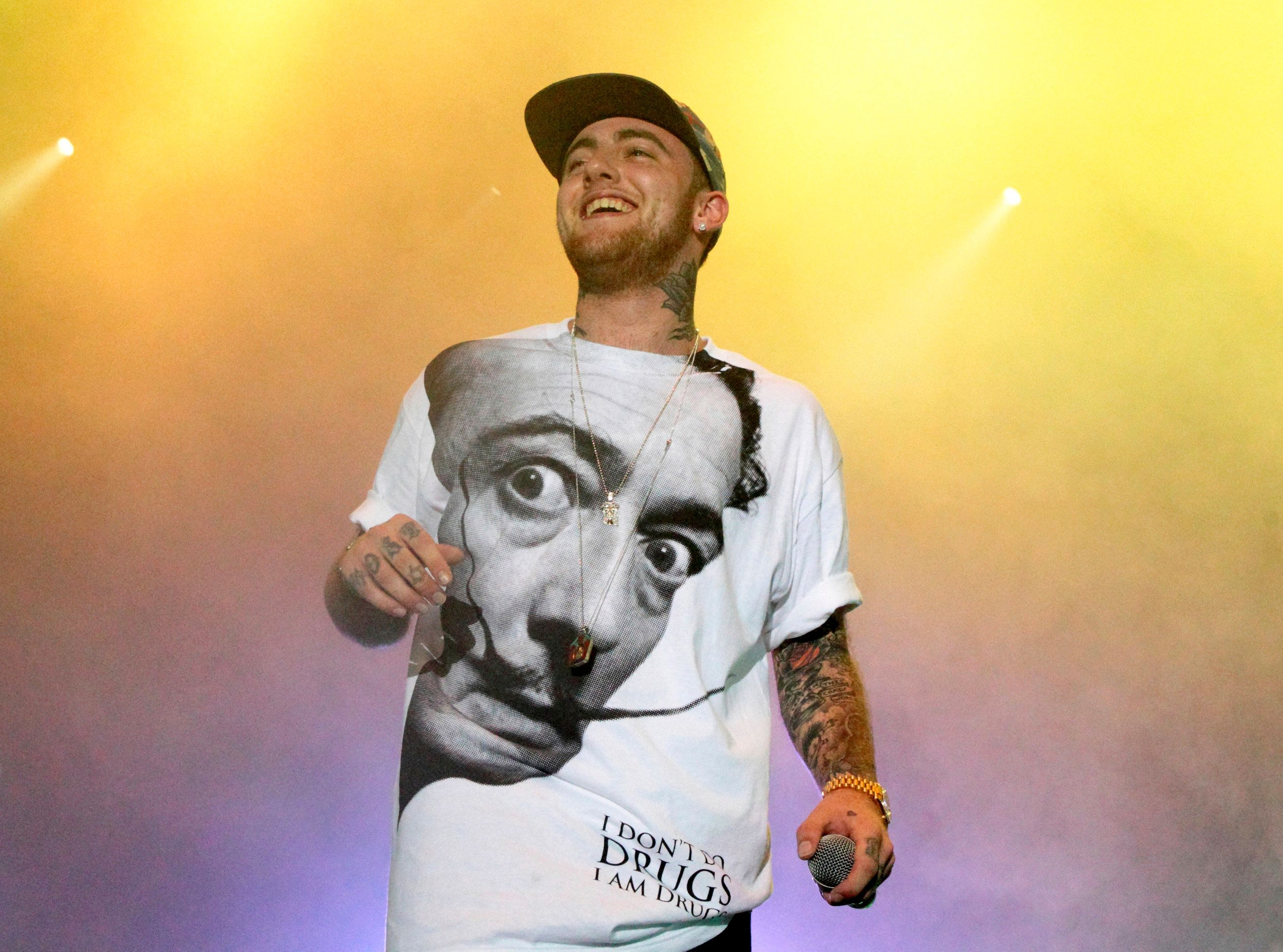 """FILE - In this July 13, 2013, file photo, Rapper Mac Miller performs on his Space Migration Tour at Festival Pier in Philadelphia. Chance the Rapper, John Mayer and SZA are set to perform at a benefit concert for late rapper Mac Miller. Live Nation announced Tuesday that Travis Scott, Miguel and Ty Dolla $ign will also perform at the """"Mac Miller: A Celebration of Life"""" concert on Oct. 31 at Los Angeles' Greek Theater. (Photo by Owen Sweeney/Invision/AP, File)"""
