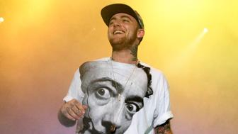 "FILE - In this July 13, 2013, file photo, Rapper Mac Miller performs on his Space Migration Tour at Festival Pier in Philadelphia. Chance the Rapper, John Mayer and SZA are set to perform at a benefit concert for late rapper Mac Miller. Live Nation announced Tuesday that Travis Scott, Miguel and Ty Dolla $ign will also perform at the ""Mac Miller: A Celebration of Life"" concert on Oct. 31 at Los Angeles' Greek Theater. (Photo by Owen Sweeney/Invision/AP, File)"