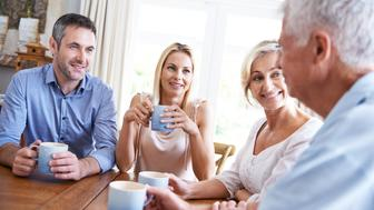 Shot of a young couple talking with their parents over coffee at homehttp://195.154.178.81/DATA/istock_collage/0/shoots/784407.jpg