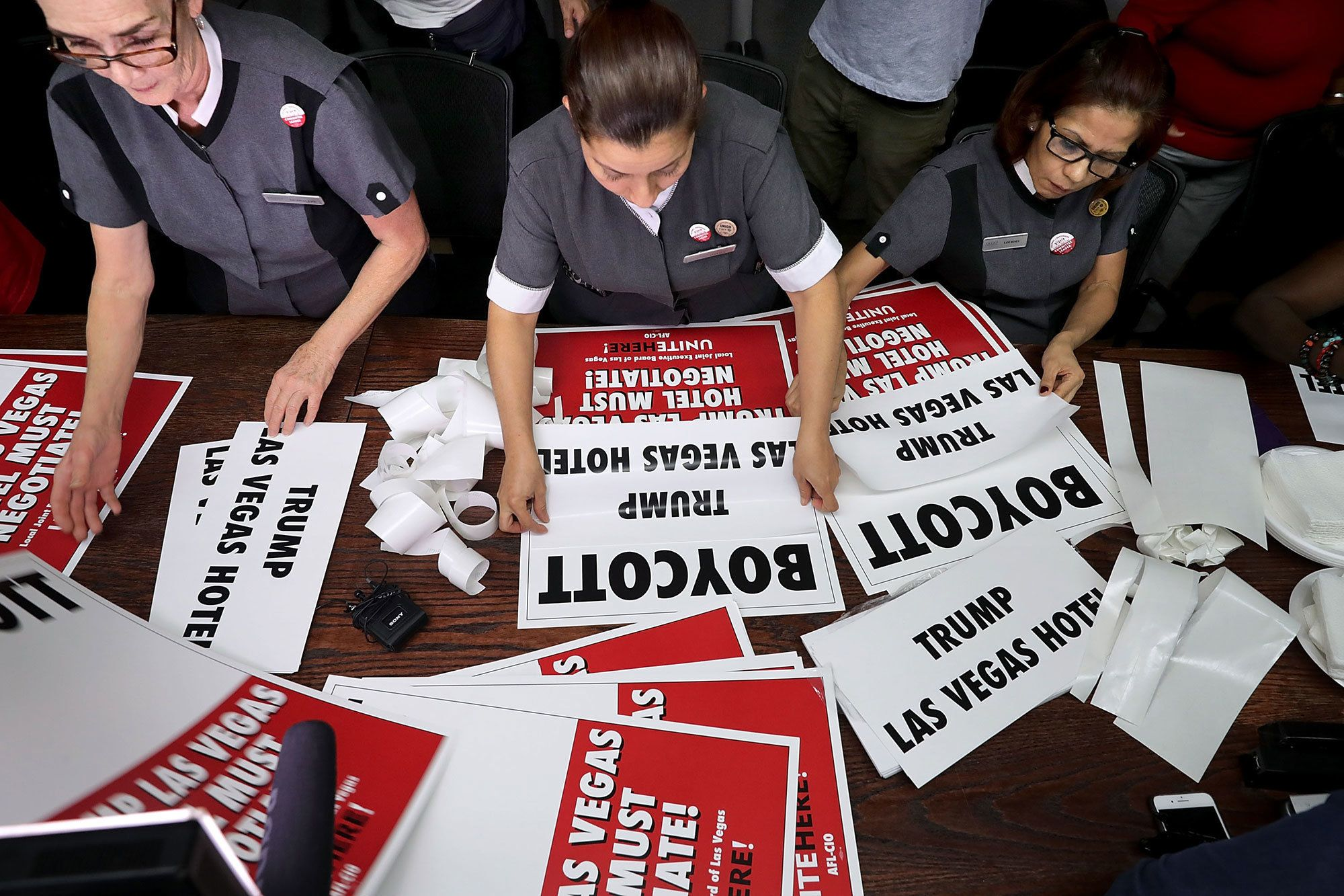 <p>Trump International Las Vegas employees and members of the Culinary Workers Union Local 226 (L-R) Guadalupe Barba, Ivelice Martinez and Lourdes Rivera assemble picket signs at their union headquarters on Oct. 18, 2016 in Las Vegas, Nev. The union members and their supporters will carry the signs as they march in front of the hotel the same day that Republican presidential nominee Donald Trump will debate Democratic presidential nominee Hillary Clinton at the University of Nevada Las Vegas. (Photo: Chip Somodevilla/Getty Images) </p>