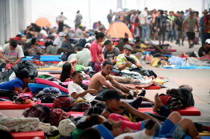 Central American migrants, part of a caravan heading to the U.S., rest at a temporary shelter set up in a Mexico City stadium