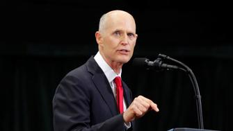 Florida Governor Rick Scott speaks at a campaign rally with U.S. President Donald Trump (not shown) in Estero, Florida, U.S.,  October 31, 2018.   REUTERS/Carlos Barria