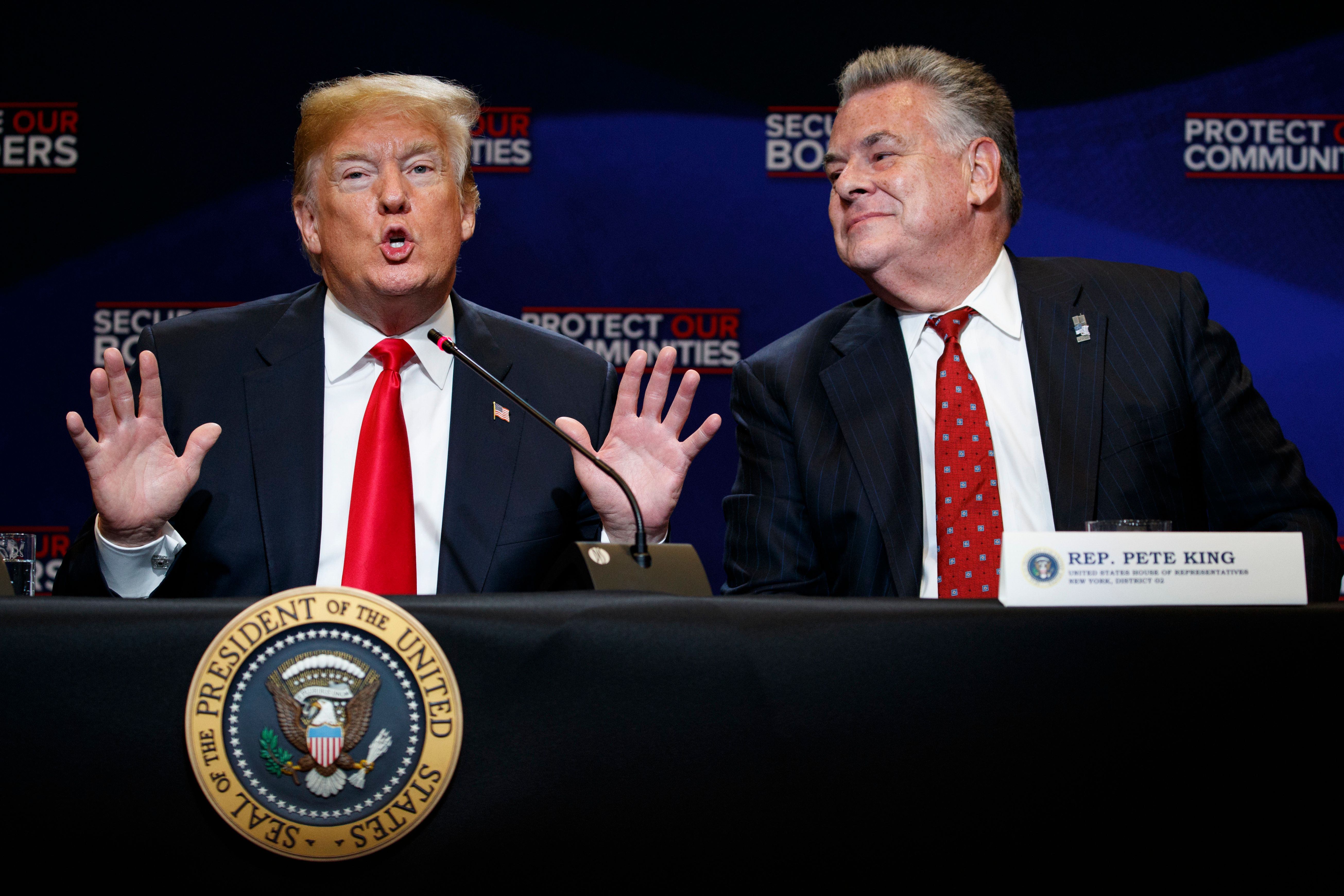 Rep. Peter King, R-N.Y., right, listens as President Donald Trump speaks during a roundtable on immigration policy at Morrelly Homeland Security Center, Wednesday, May 23, 2018, in Bethpage, N.Y. (AP Photo/Evan Vucci)