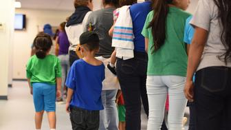 FILE - In this Aug. 9, 2018, file photo, provided by U.S. Immigration and Customs Enforcement, mothers and their children stand in line at South Texas Family Residential Center in Dilley, Texas. A complaint expected to be filed Thursday, Aug. 23 with the Department of Homeland Security alleges that immigration authorities coerced dozens of parents separated from their children at the border to sign documents they didn't understand. In some of those cases, parents gave away rights to be reunited with their kids. The complaint will be filed by the American Immigration Lawyers Association and the American Immigration Council. (Charles Reed/U.S. Immigration and Customs Enforcement via AP, File)