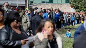 A line forms for early voting at the Hamilton County Board of Elections, Sunday, Nov. 4, 2018, in Cincinnati. (AP Photo/John Minchillo)