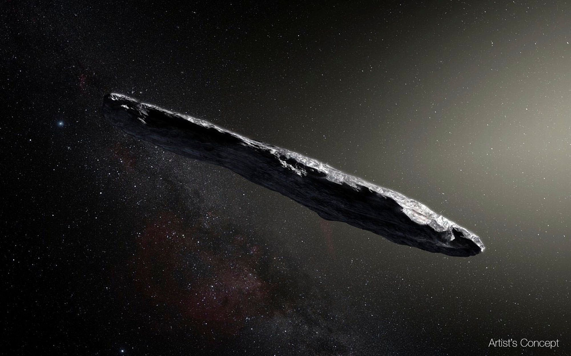"""FILE - This artist's rendering provided by the European Southern Observatory shows the interstellar object named """"Oumuamua"""" which was discovered on Oct. 19, 2017 by the Pan-STARRS 1 telescope in Hawaii. In the Wednesday, June 27, 2018 edition of the journal Nature, a European-led team makes the case it is a comet, not an asteroid. (M. Kornmesser/European Southern Observatory via AP)"""