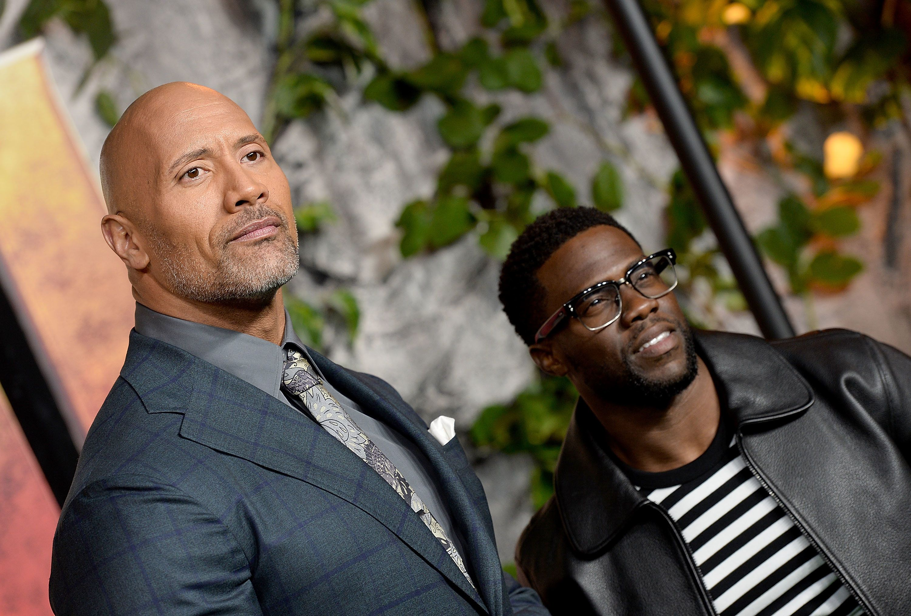 LONDON, ENGLAND - DECEMBER 07:  Dwayne Johnson (L) and Kevin Hart attend the 'Jumanji: Welcome To The Jungle' UK premiere held at Vue West End on December 7, 2017 in London, England.  (Photo by Jeff Spicer/Jeff Spicer/Getty Images)