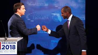 Florida gubernatorial candidates, Republican Ron DeSantis, (L), and Democrat Andrew Gillum fist bump after a debate, at Broward College in Davie, Florida, U.S. October 24, 2018.     Wilfredo Lee/ Pool via REUTERS