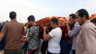 Iraqi mourners attend a funeral after a car bomb attack on October 23, 2018 killed six people and wounded 26 more at a market in Al Qayyarah, 60 kilometres (40 miles) south of the Islamic State (IS) group's former Iraqi capital of Mosul. - Al Qayyarah was held by IS after they swept through northern Iraq in 2014. The jihadists were ousted from the town in 2016, almost a year before they were driven out of Mosul. (Photo by Zaid AL-OBEIDI / AFP)        (Photo credit should read ZAID AL-OBEIDI/AFP/Getty Images)