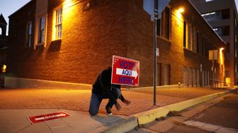 EL PASO, EL PASO - NOVEMBER 06: Volunteer Albert Lopez, 18, sets out signs directing voters to a polling place at El Paso Community College-Rio Grande Campus before dawn on Election Day November 06, 2018 in El Paso, Texas. In Texas, Rep. Beto O'Rourke (D-TX) is in a surprisingly tight contest against incumbent Sen. Ted Cruz (R-TX) for the state's U.S. Senate race. (Photo by Chip Somodevilla/Getty Images)