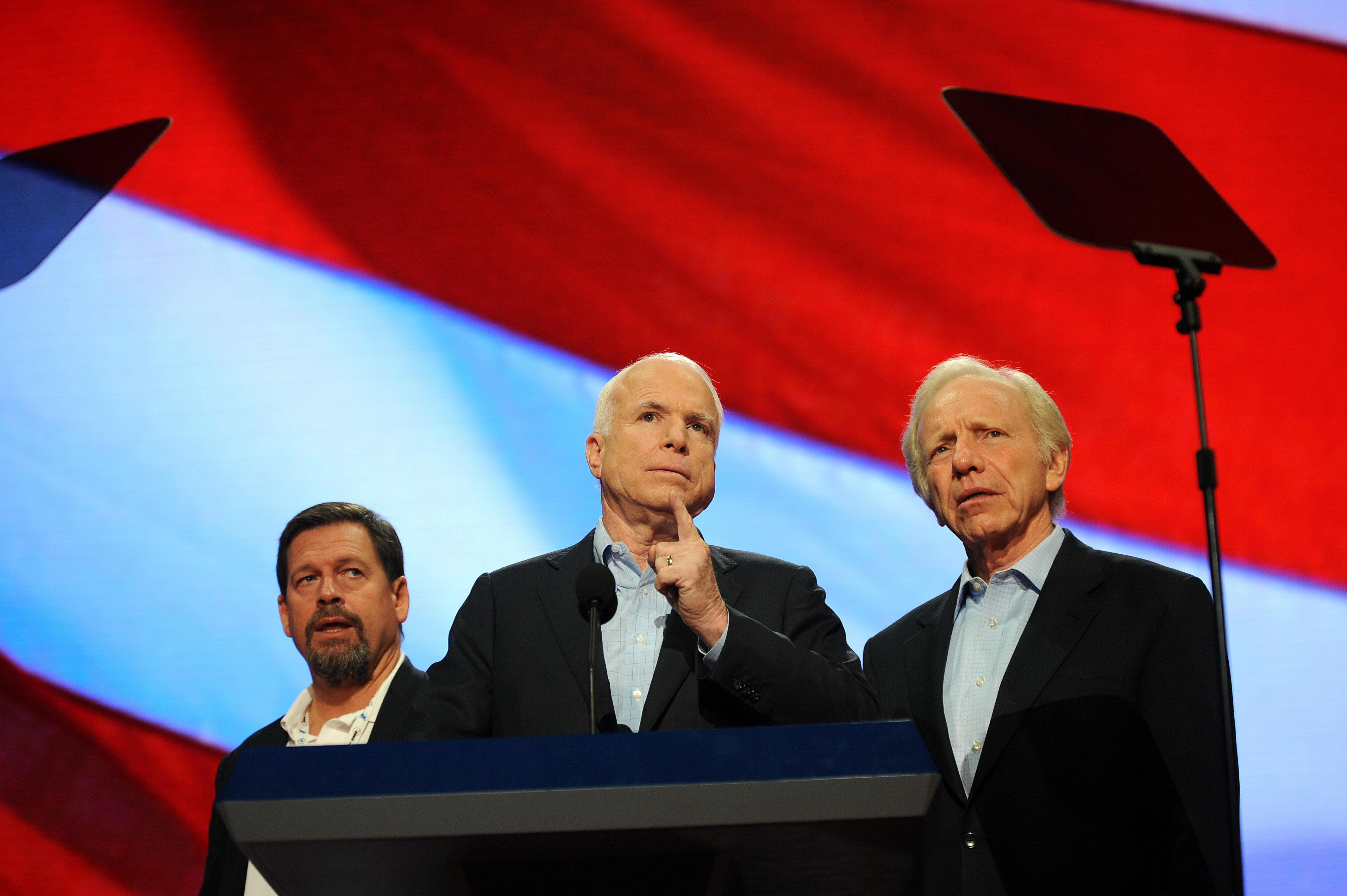 US Republican presidential candidate Arizona Senator John McCain (C) is flanked by US Senator Joe Lieberman (I-CT)  and senior advisor Mark Salter (L) during a walk-through to check the podium and stage before his keynote address this evening, at the Republican National Convention (RNC) in St. Paul, Minnesota on September 4, 2008.  AFP PHOTO Robyn BECK (Photo credit should read ROBYN BECK/AFP/Getty Images)