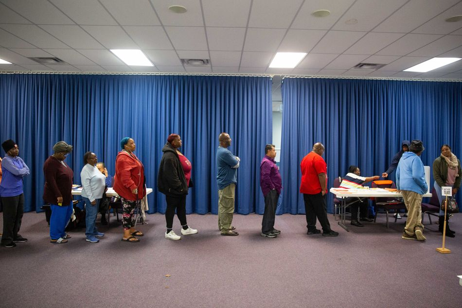 Voters wait in line to cast their ballots at a polling station in Atlanta, Georgia.