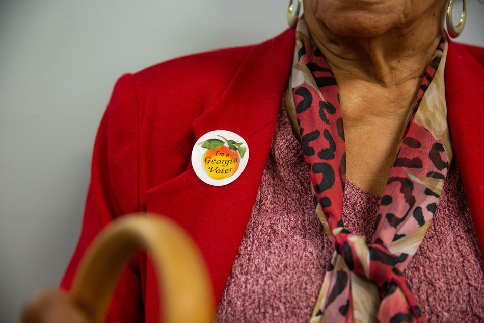 "A voter wears a sticker that reads ""I'm a Georgia Voter"" at a polling station in Atlanta, Georgia."
